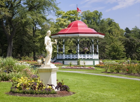 bandstand: The bandstand gazebo and the statue of the Roman goddess Flora at the Halifax Public Gardens in Halifax, Nova Scotia, Canada.
