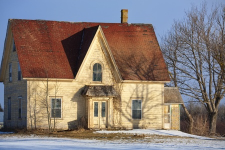 edward: An old abandoned Prince Edward Island farmhouse in the early winter.