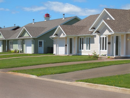 A row of family town houses in an urban neighbourhood.