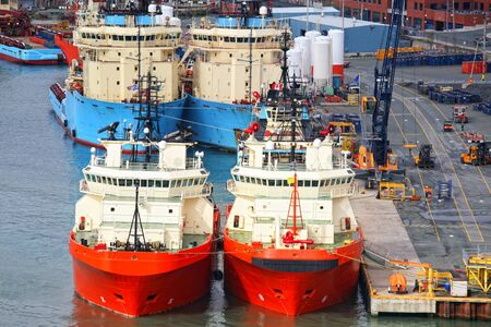 nfld: Offshore supply vessels tied up at a commercial pier in St. Johns, Newfoundland, Canada. Editorial