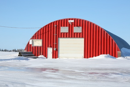 storage: Potato storage warehouse facility surrounded by ice and snow on Prince Edward Island, Canada.