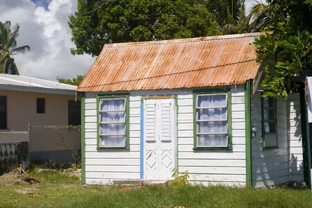 shutter door: The Chattel House in Barbados was originally  the design of the plantation workers home. They were modest wooden buildings set on blocks so that they could be easily moved from one leaseholding to another.