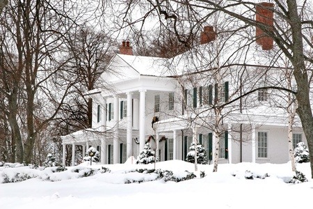 white winter: Georgian inspired archecture in this large snow covered home.  Government House or Fanning Bank is home of the Liet. Govenor of Prince Edward Island, Canada.