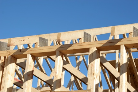 rafters: The wooden rafters in a new house roof.