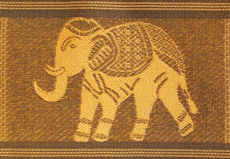 Close up of an example of a silk woven Thai fabric with the picture of an elephant.