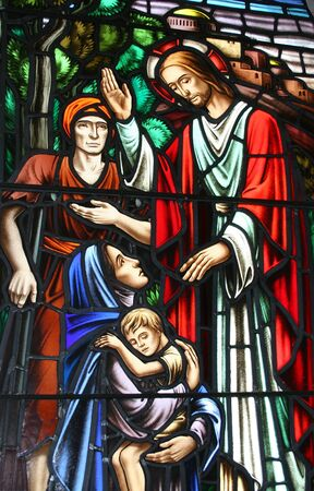 A biblical portrayal of healing in stained glass.
