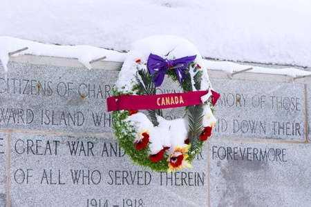 commemorating: The War Memorial commemorating soldiers of the First World War in Charlottetown, Prince Edward Island, covered with an early winter snowfall.