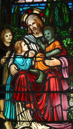 Stained glass pictorial of Jesus and the children.