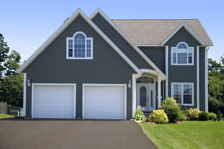 driveways: A new family home in a subdivision.