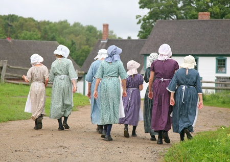 reenactment re enactment: Re-enactment of a pioneer village with a group in period costume. Editorial