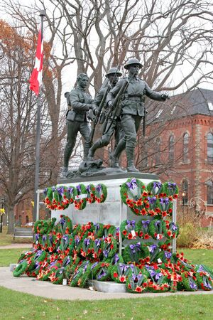 Rembrance Day wreaths placed at the base of a war memorial to the veterans of the first and second world war.  Monument is located in Charlottetown, Prince Edward Island, Canada.
