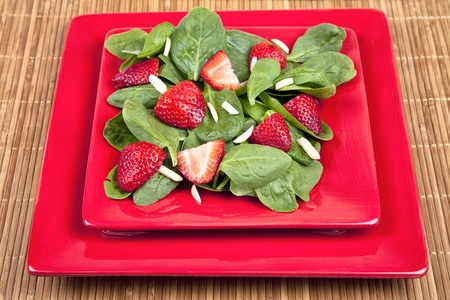 Spinach strawberry salad with homemade dressing and almonds.