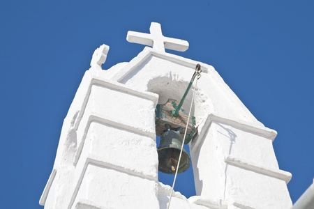 Bell in a bell tower of a classic Greek Church on the island of Mykonos.