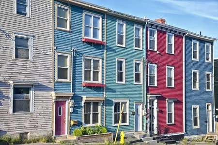 nfld: Traditional wooden row houses on the hilly streets of St. Johns, Newfoundland, Canada Stock Photo