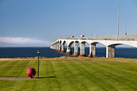 strait: Traffic crossing over the Northumberland Strait from New Brunswick to Prince Edward Island via the Confederation Bridge.  Large red buoy in the foreground.