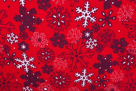 Christmas fabric with a bold snowflake pattern. Stock Photo
