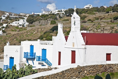 Family chapels and residential buildings on a hillside village on the island of Mykonos, Greece.