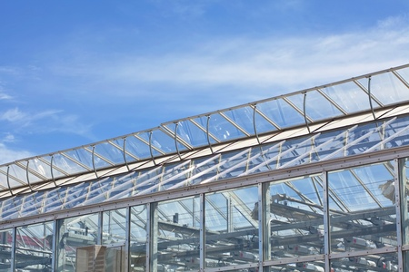 Vents on a large commercial glass greenhouse