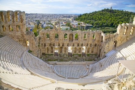 past civilizations: The Odeon of Herodes Atticus on the south slope of the Acropolis in Athens, Greece. c 161 AD.  The city of athens is in the background.