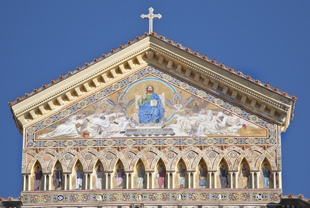 Facade of Saint Andrews cathedral   in Amalfi, Italy is covered with Byzantine mosaic entiltled The Triumph of Christ.   Stock Photo