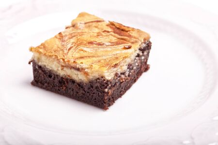 chocolate icing: Cheesecake brownies with cream cheese icing.