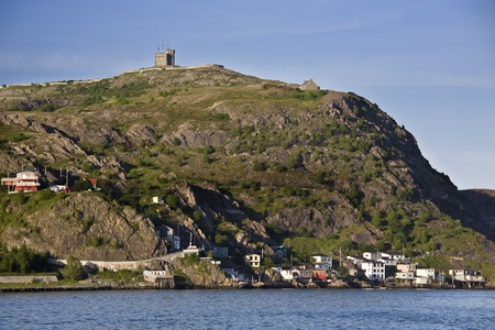 Cabot tower on the top of Signal Hill and the residential area of the Lower Battery on the lower slopes are located in St. Johns, Newfoundland. Stock Photo