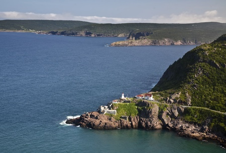 View from Signal Hill, St. Johns, Newfoundland of the National Historic Site of Fort Amherst and the lighthouse on the point. The remains of gun emplacements built during WW2 are still visible.