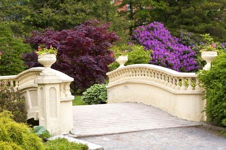 An ornamental pedestrian bridge in a springtime garden in Halifax, Nova Scotia, Canada. photo