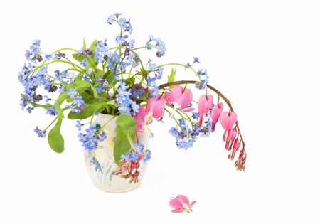 Forget-me-nots and bleeding hearts in a spring bouquet. photo