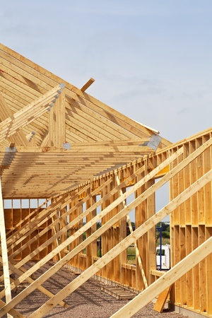 2x4 wood: New construction of a wooden building or house. Editorial