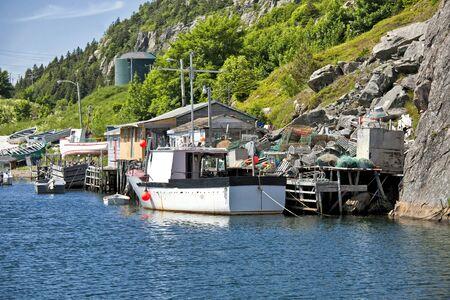 nfld: Fishing boats and fishing shacks in Quidi Vidi, outside of St. Johns, Newfoundland. Stock Photo