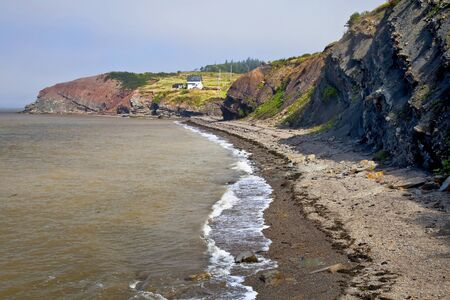World famous fossil cliffs on the Bay of Fundy, at Joggins, Nova Scotia, Canada. photo