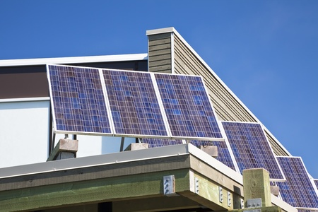 save electricity: Solar panels on the roof of a building.