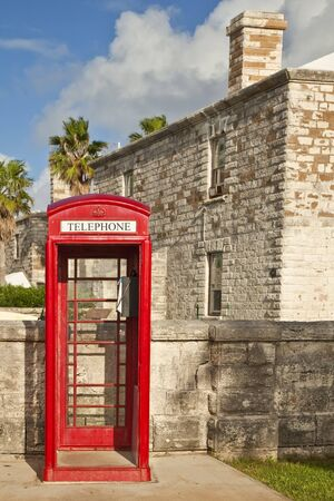 dockyard: A red telephone box, typical of English influence, in the Royal Naval Dockyard, Bermuda.