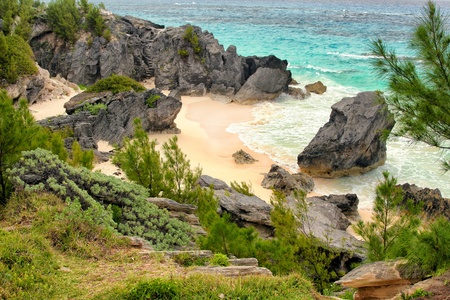A small but private hidden beach on the island of Bermuda.