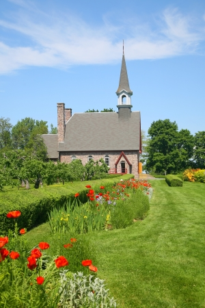 commemorating: The Memorial Church of Grand Pre located in the Annapolis Valley of Nova Scotia in the Grand Pre National Historic Site, a park commemorating the deportation of the Acadians between 1755 and 1763.
