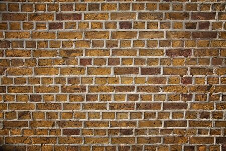 morter: A weathered old brick wall with extesive morter.