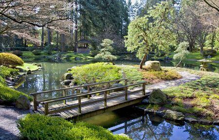 japenese: View of a garden bridge in a tranquil Japanese garden.