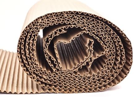 celulosa: Una sección de enrollado de cartón corrugado Foto de archivo