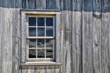 weathered: Window of an authentic wooden pioneer house Stock Photo
