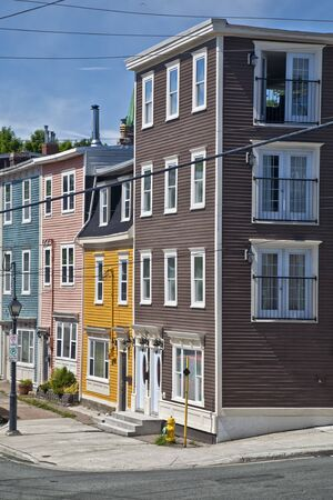 Unique architecture in the colorful houses on the steep streets of St. John's, Newfoundland.  Stock Photo - 15637317