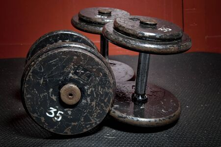 An old but well used set of dumbbells at the gym. photo