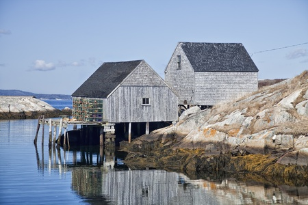 commercial fisheries: Lobster traps and fishing sheds in the small fishing village and tourism destination of Peggys Cove, Nova Scotia, Canada. Stock Photo