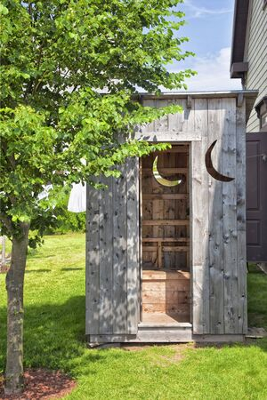 ideally: A wooden outhouse ideally located in the backyard.