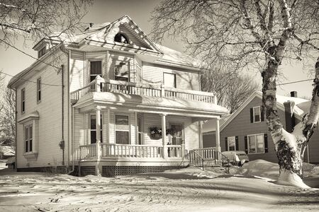 An older style family home after a snowfall. Stock Photo - 17589540