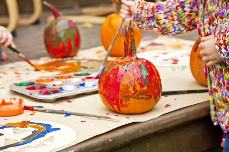 colorfully: Pumpkins colorfully painted by children. Stock Photo