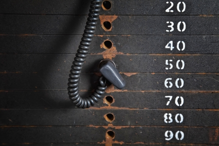 Old rusty weight stack in a gym. Stock Photo