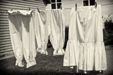 Selection of vintage womens underwear hanging on a clothsline. Stock Photo
