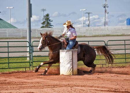 arena rodeo: Western horse and rider competing in pole bending and barrel racing competition. Stock Photo