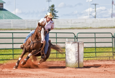 western saddle: Western horse and rider competing in pole bending and barrel racing competition. Stock Photo